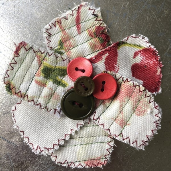 red green and cream scrap fabric flower