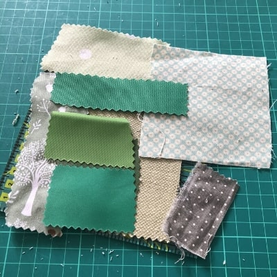 green fabric scraps for baby colour book