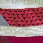 scrap quilt with scrappy binding