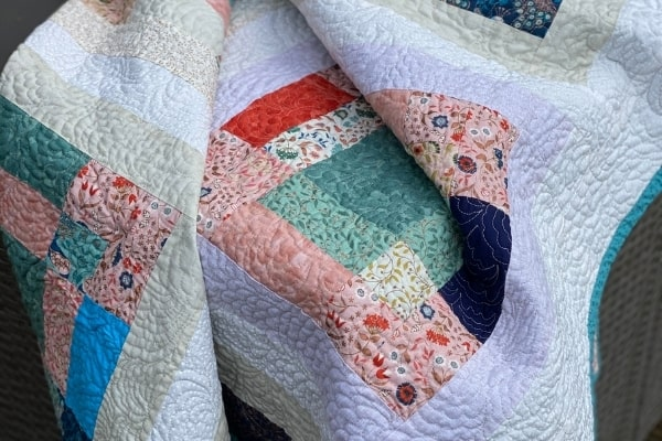 disappearing 9 patch scrappy quilt