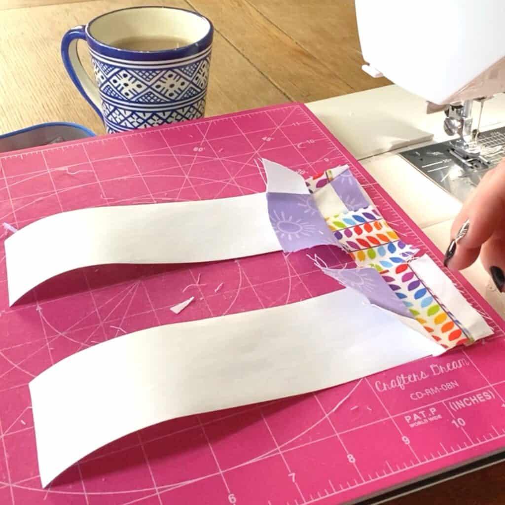 sew scraps to adding machine tape