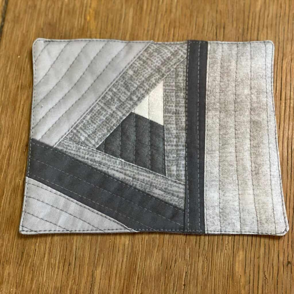 quilted coaster - grey fabric with triangle